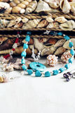 Collection of jewelry in jewelry box decorated with seashells Stock Photo
