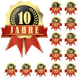 Collection of jubilee buttons. With banner and ribbons for 10 years (in german) and others Royalty Free Stock Images