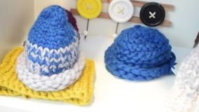 Collection of knitted caps on white background stock video