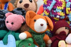 A collection of knitted soft toys on the street stock images