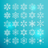 Collection of 25 lacy white snowflakes. On a blue background for Christmas or New Year Royalty Free Stock Photo