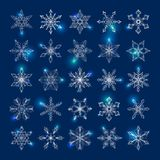 Collection of 25 lacy white snowflakes. Collection of 25 lacy linear snowflakes on a dark blue background for Christmas or New Year design Royalty Free Stock Image