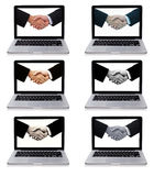 Collection of laptops with business handshake Royalty Free Stock Images