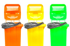 Collection of large colorful trash cans (garbage bins) isolated on white Stock Photo