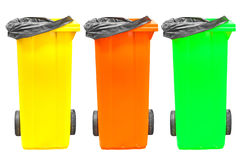 Collection of large colorful trash cans (garbage bins) isolated on white Stock Image