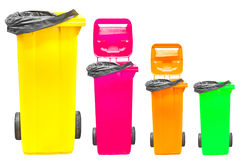 Collection of large colorful trash cans (garbage bins) isolated on white Stock Photography