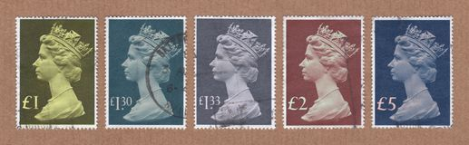Collection of large size, tall format, British Royal Mail postage stamps. royalty free stock photography