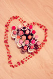 Collection of lipsticks with heart necklace Royalty Free Stock Photo