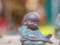 Zither-playing novice statue in close-up shoot. This is a collection of littile novice statues in different emotions. In real situation, it just has 5cm in tall stock images