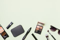 A collection of make up and cosmetic beauty green background Royalty Free Stock Photography