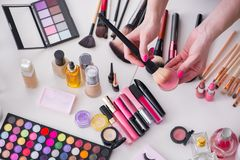 The collection of make up products displayed on the table Royalty Free Stock Photo