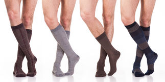 Collection of man socks on foot isolated on white Stock Photo