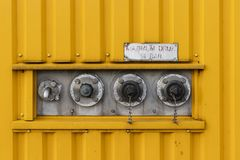 Collection of manifolds on yellow striped pattern royalty free stock images
