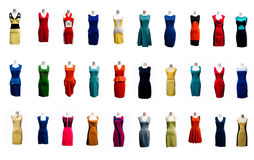 Collection of many color evening gown dress on mannequin. Royalty Free Stock Images