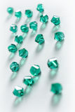 Collection Of Many Green Double Cones Crystals In A White Box Royalty Free Stock Photo