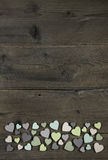 Collection of many handmade hearts in natural colors on old wood Stock Photo