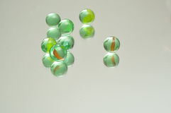 A collection of marbles. Reflecting into a white background Royalty Free Stock Photo