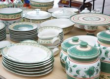 Collection of matching dishes for sale at a garage sale. Collection of matching dishes for sale at a suburban American garage sale royalty free stock image