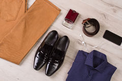 Collection of men's clothing and accessories. Collection of men's clothing and accessories on a wooden background Stock Images