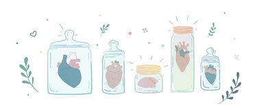 Collection of men's hearts in glass jars. Royalty Free Stock Photos
