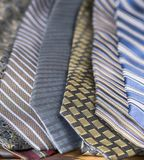 Collection of men`s neckties in stripes and patterns. Shallow depth of field, close up, of mens neckties in stripes and patterns stock photos