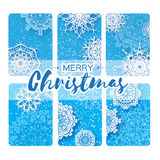 Collection of 6 Merry Christmas and New Year Greeting card. With paper cut origami snowflakes on blue backgound. Vector seasonal badge design Royalty Free Illustration