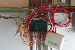 A collection of messy wires and power boxes royalty free stock photo