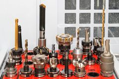 CNC tools. Collection of milling and drilling tools for CNC machine Stock Image