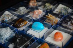 Collection of minerals and precious stones in glass boxes stock image