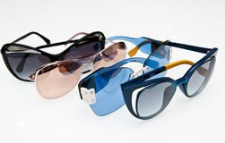 Collection of fashionable sunglasses on white royalty free stock images