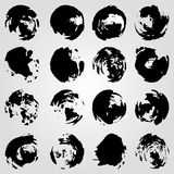 Collection of monochrome ink blots on a light background Royalty Free Stock Image