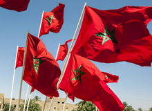 A collection of Moroccan flags flying in Meknes, Morocco. The flag of Morocco has red with a green pentacle five-pointed, linear star known as Sulayman's ( Royalty Free Stock Photo