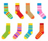 Collection of multi-colored socks with patterns and stripes Royalty Free Stock Photos