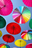 Collection of multi colored umbrellas hanging up. Stock Images