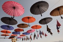 Multicolored umbrellas hanging over head on the street, Yazd, Ir Royalty Free Stock Photo