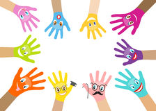 Collection of multicolored hands with smiles Stock Photos