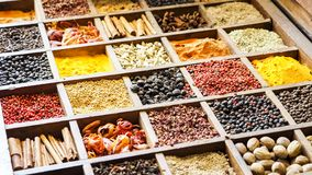 Collection colorful mosaic spices in wooden box. Assortment of condiment cooking ingredient. Seasoning background. Collection multicolored mosaic spices stock image