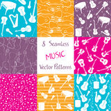 Collection of music seamless patterns. Collection of seamless patterns with musical instruments. Colorful repeating vector patterns for background Royalty Free Stock Images