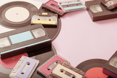 Collection of music tapes, records and video cassettes on paper background. Retro concept royalty free stock photography
