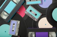 Collection of music tapes, records and video cassettes. Retro co. Ncept stock photos