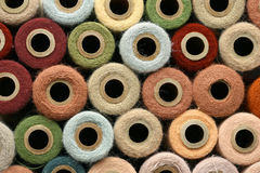 Collection of Natural Colored Vintage Yarn Spools Background Stock Images
