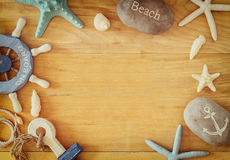 Collection of nautical and beach objects creating a frame over wooden background, Stock Photos