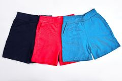 Collection of new colored kids shorts. royalty free stock photo