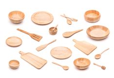 Collection of new wooden kitchen utensil, bowl, plate, spoon, di. Sh. Studio shot isolated on white background Royalty Free Stock Image