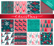 Collection of nine hand drawn winter holidays seamless patterns Stock Images
