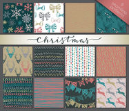 Collection of nine hand drawn winter holidays seamless patterns Royalty Free Stock Image