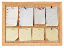 Collection of note papers on cork board Stock Image