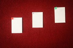Collection of note papers pinned on a red board ready for filling in quotes. Collection of note papers pinned on a red board ready for filling in quotes royalty free stock photography