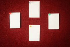 Collection of note papers pinned on a red board ready for filling in quotes. Collection of note papers pinned on a red board ready for filling in quotes stock photo