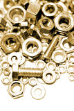 Collection of nuts and bolts. A color modified view of a variety of nuts and bolts Stock Photography